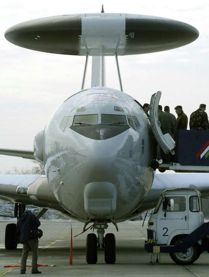 A Hungarian photographer (left) takes pictures of a NATO E-3 AWACS aircraft at the military airfield in Kecskemet, Hungary, on Jan. 25, 2007. Photo: FERENC ISZA, AFP/Getty Images / 2007 AFP