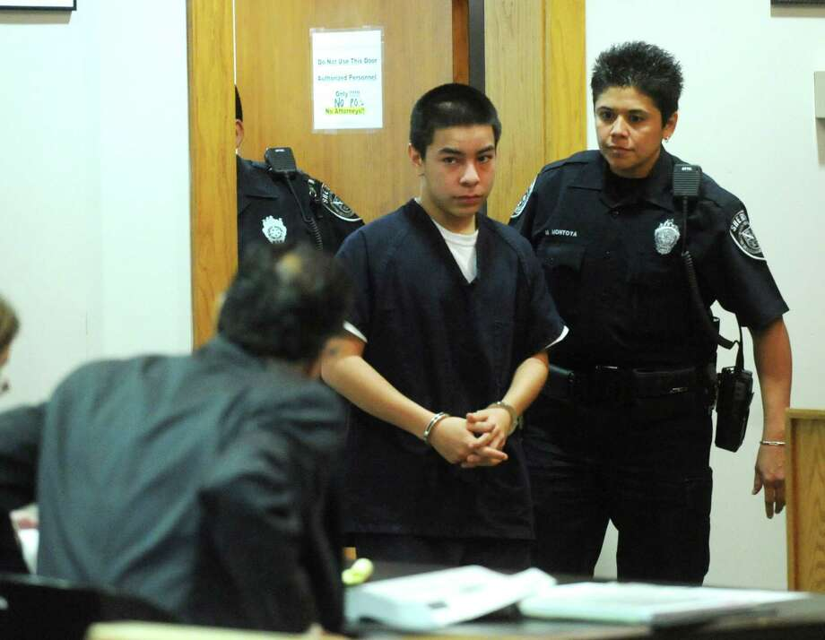 John Gonzales III enters juvenile-focused 386th District Court for the hearing on whether he'll be tried as an adult. Photo: Billy Calzada, San Antonio Express-News / © 2012 San Antonio Express-News