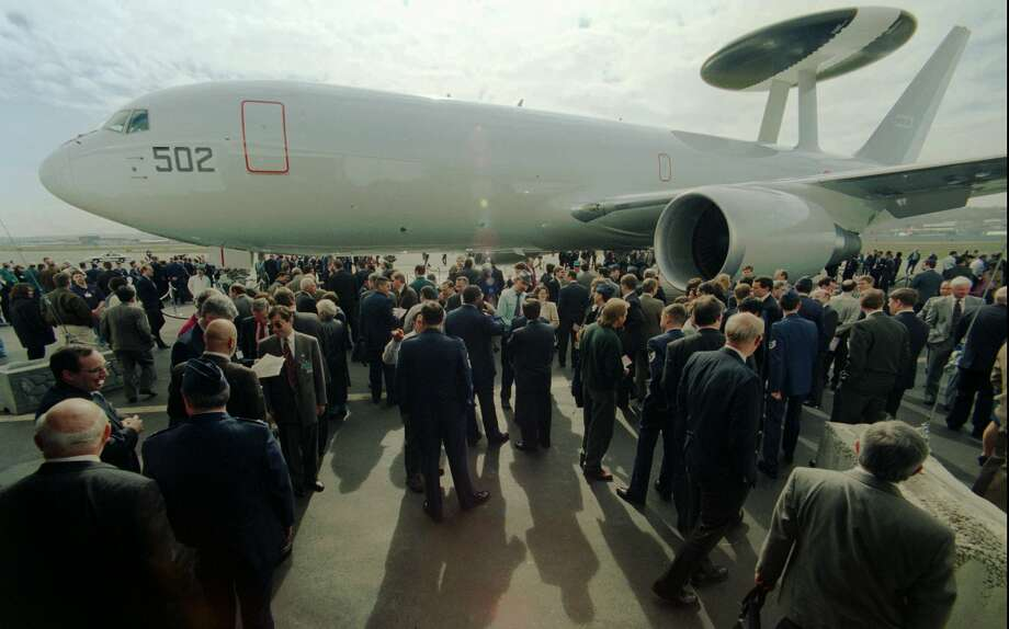 Boeing has also produced 767-based AWACS jets for Japan. Here, guests get a closeup look at the aircraft during a delivery ceremony on March 11, 1998. Photo: BARRY SWEET, Associated Press / AP