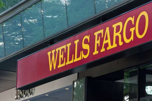 (FILES)A view of a Wells Fargo bank branch in Washington, DC is seen in this April 13, 2012 photo.   Wells Fargo Bank said October 12, 2012 that strong loan growth, especially in mortgages and improved credit quality, helped boost its third quarter bottom line by 22 percent over the previous year. The second US bank, after JP Morgan Chase, to cite the rebounding home mortgage business for its quarterly gains, Well Fargo said net earnings for the three months to September 30 were $4.94 billion, compared to $4.06 billion a year before. AFP PHOTO/Nicholas KAMMNICHOLAS KAMM/AFP/GettyImages