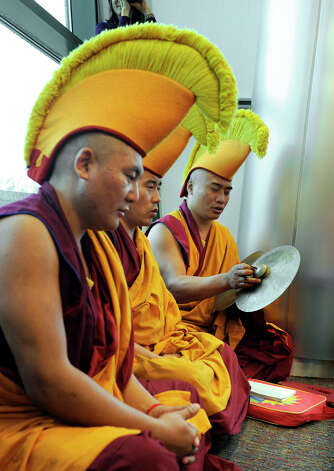Tibetan Buddhist monks perform a ceremony in which they dissolve the sand mandala that they created in honor of the visit of the Dalai Lama to Danbury, Friday, Oct. 19, 2012. Photo: Carol Kaliff / The News-Times