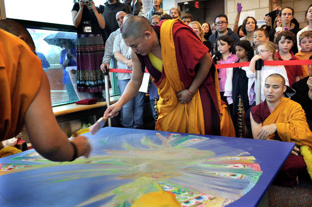 Tibetan Buddhist monks dissolve the sand mandala that they created in honor of the visit of the Dalai Lama to Danbury, Friday, Oct. 19, 2012. Photo: Carol Kaliff / The News-Times