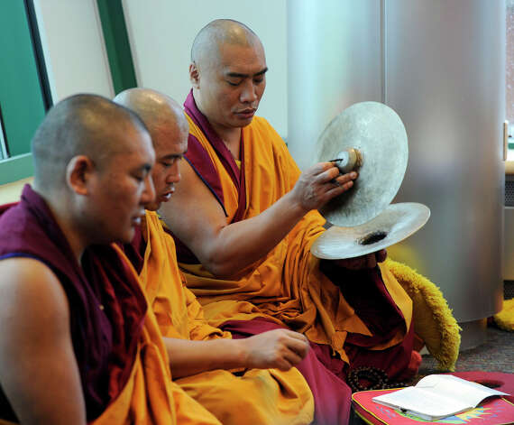 Tibetan Buddhist monks perform a ceremony before they dissolve the sand mandala that they created in honor of the visit of the Dalai Lama to Danbury, Friday, Oct. 19, 2012. Photo: Carol Kaliff / The News-Times