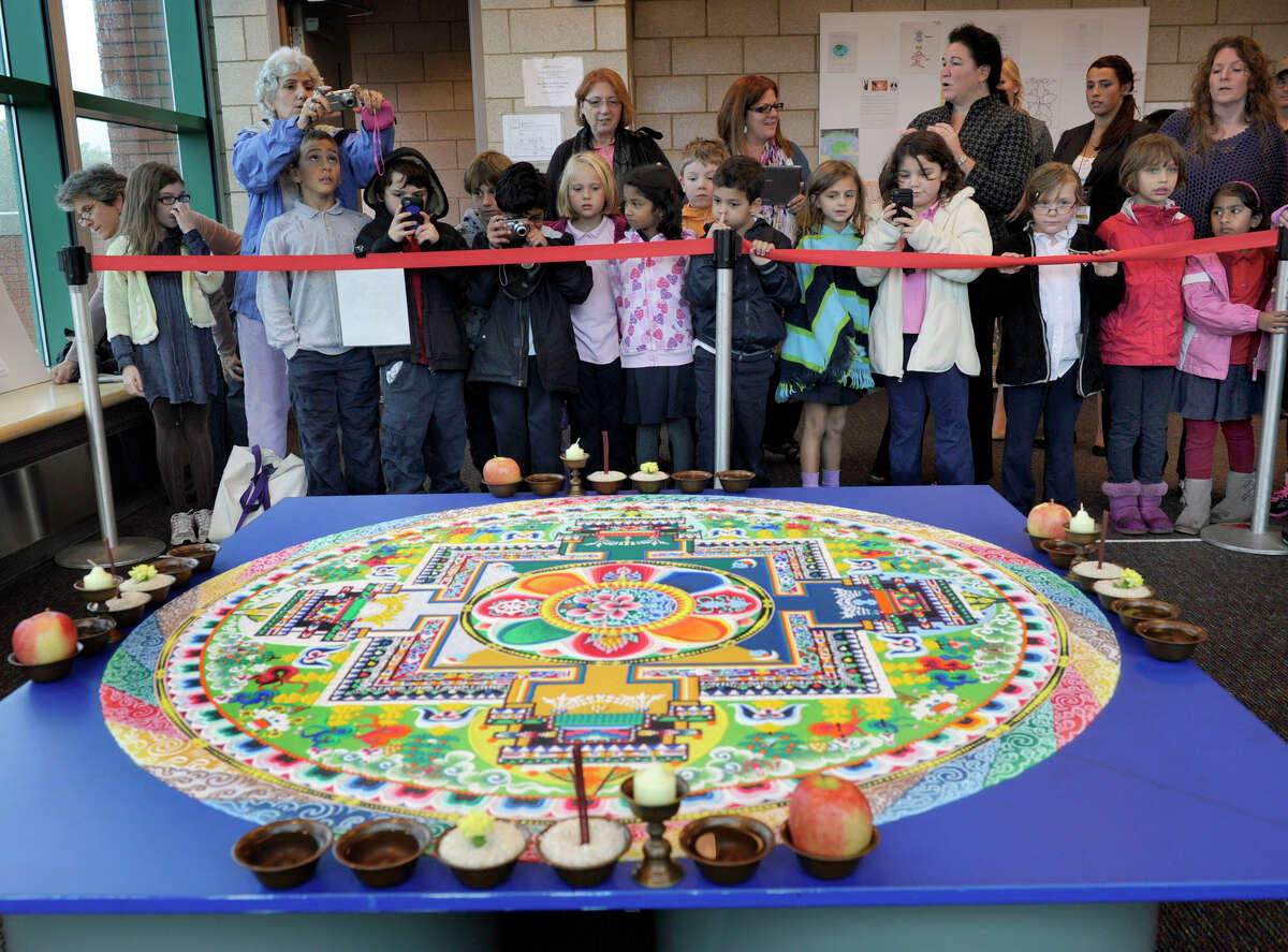The completed mandala, created by Tibetan Buddhist monks this week, in honor of the visit of the Dalai Lama to Danbury, awaits a ceremony which will end in the disolving of the mandala, Friday, Oct. 19, 2012.