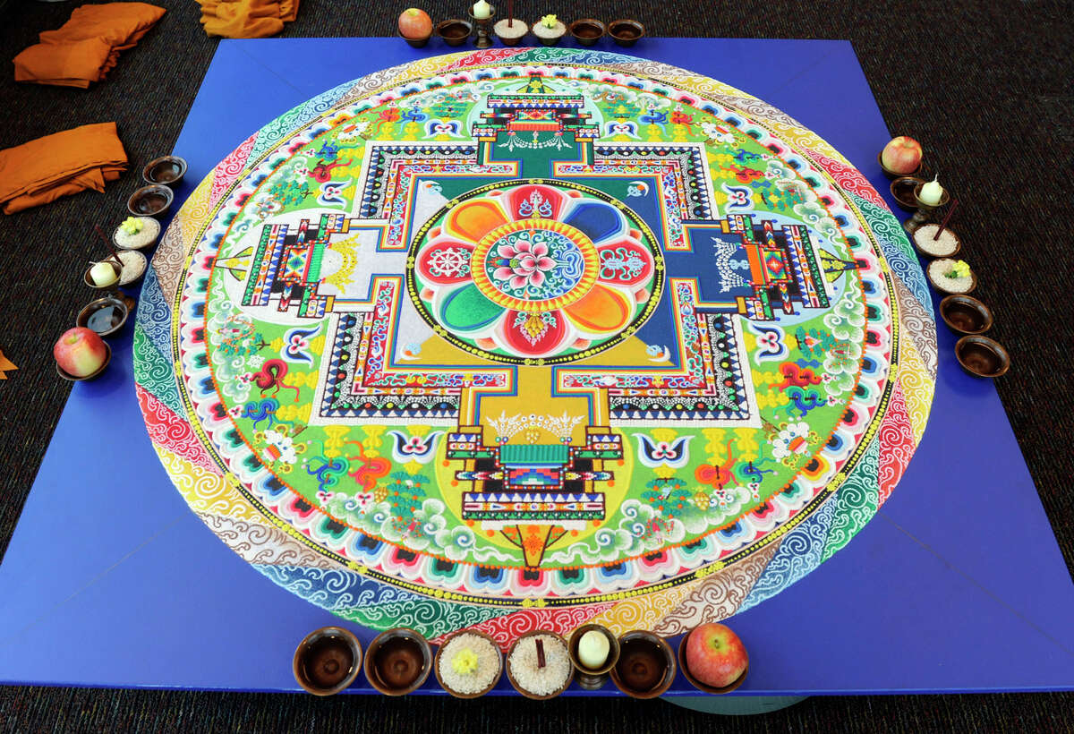 The completed mandala, created by Tibetan Buddist monks this week, in honor of the visit of the Dalai Lama to Danbury, awaits a ceremony which will end in the dissolving of the mandala, Friday, Oct. 19, 2012.