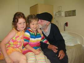 The late Bernie Kern, who died Oct. 9, 2012, in San Francisco, visited over the past year with friends Maureen Loftus, 7, on left and her sister Vivian Loftus, 5, in the middle. They came to visit him at Laguna Honda Hospital, where Kern died.