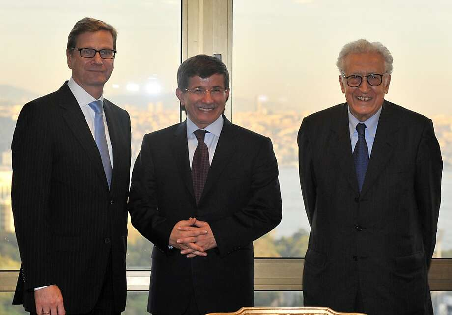 Peace envoy Lakhdar Brahimi (right), receives support in his efforts from German Foreign Minister Guido Westerwelle (left) and Turkish Foreign Minister Ahmet Davutoglu. Photo: Bulent Kilic, AFP/Getty Images
