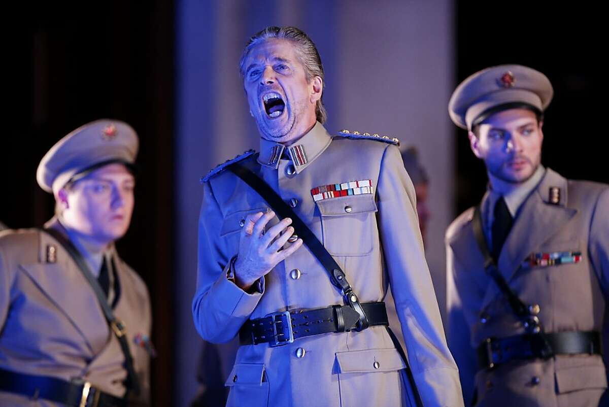 Gerd Grochowski (center), as Friedrich von Telramund, performs during a dress rehearsal for Lohengrin at the San Francisco War Memorial Opera House on Wednesday, October 17, 2012 in San Francisco, Calif.