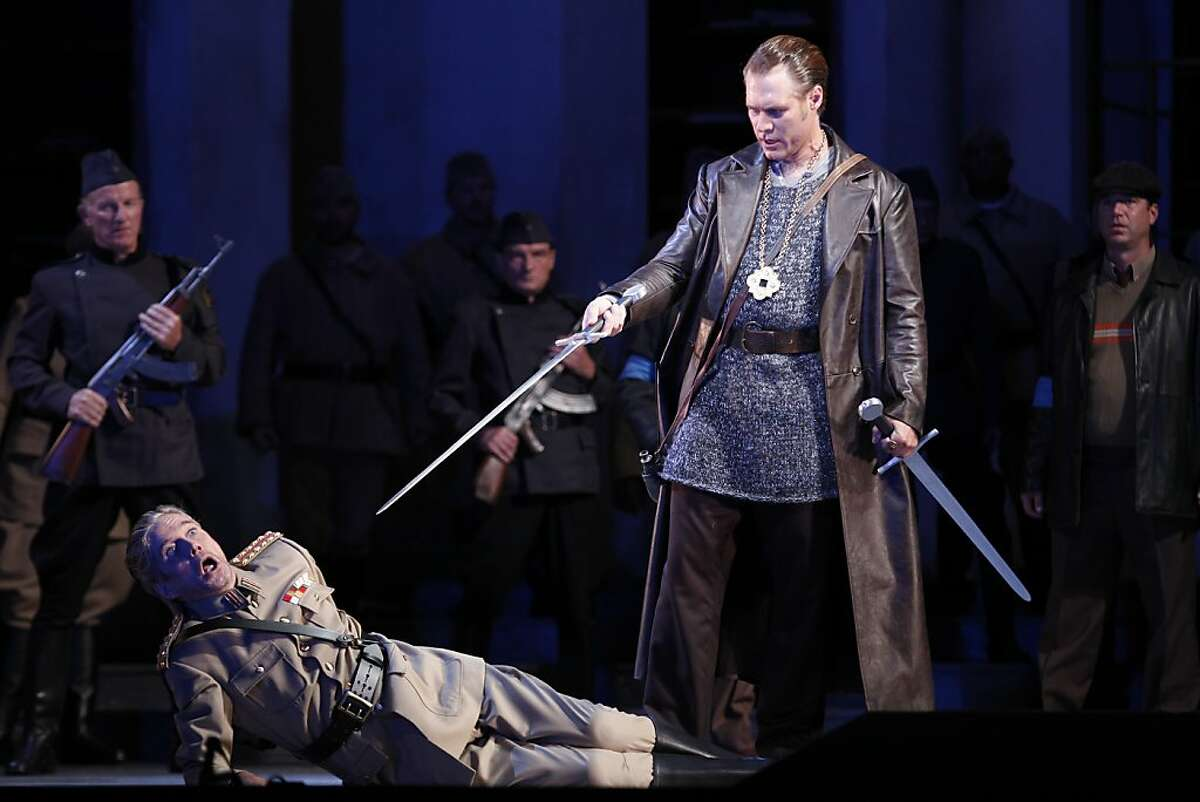 Gerd Grochowski (left), as Friedrich von Telramund, and Brandon Jovanovich, as Lohengrin, perform during a dress rehearsal for Lohengrin at the San Francisco War Memorial Opera House on Wednesday, October 17, 2012 in San Francisco, Calif.