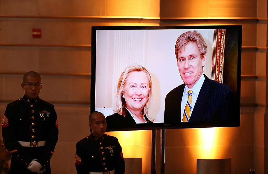 A photo of J. Christopher Stevens and Secretary of State Hillary Clinton at his memorial in S.F. Photo: Justin Sullivan, Getty Images