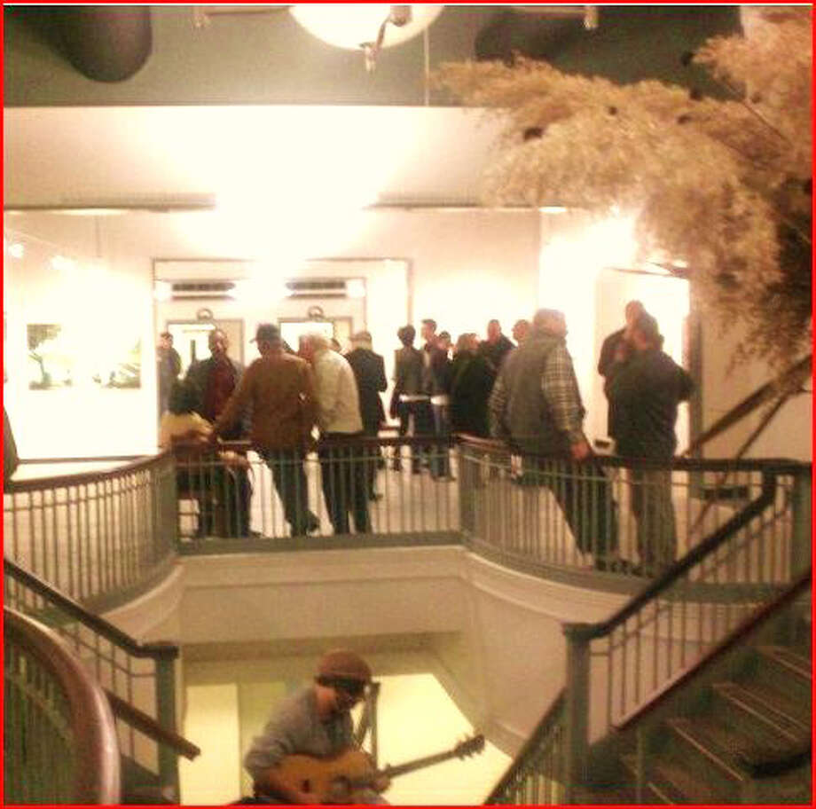 The 4th annual Bridgeport ArtTrail runs Veteran's Day weekend, Nov. 8-11. Above, a 2011 reception at the Read's Artspace in downtown. Photo: Contributed Photo