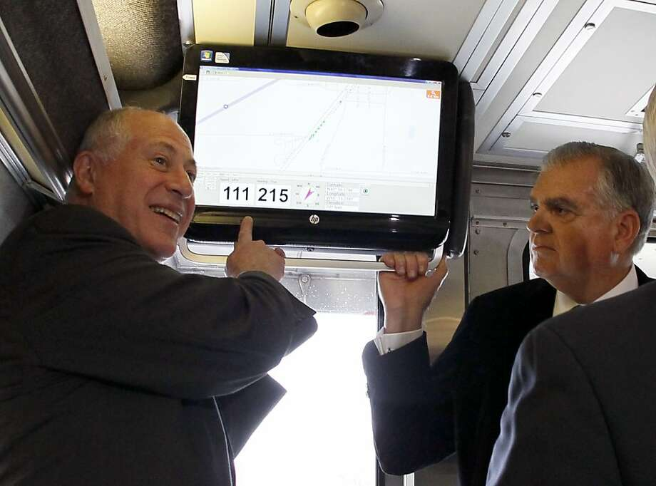 Illinois Gov. Pat Quinn (left) points out the speed of the train he and U.S. Transportation Secretary Ray LaHood are riding. Photo: Charles Rex Arbogast, Associated Press