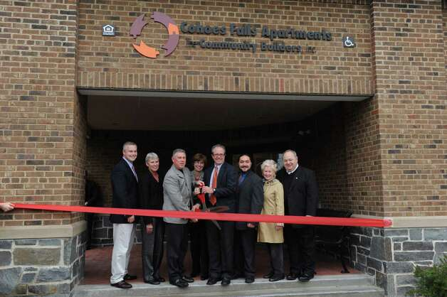 A ribbon cutting ceremony to celebrate the completion of renovations to Cohoes Falls Apartments, a 66-unit, seven-site affordable family housing development in Cohoes, NY Friday Oct. 19, 2012. (Michael P. Farrell/Times Union) Photo: Michael P. Farrell
