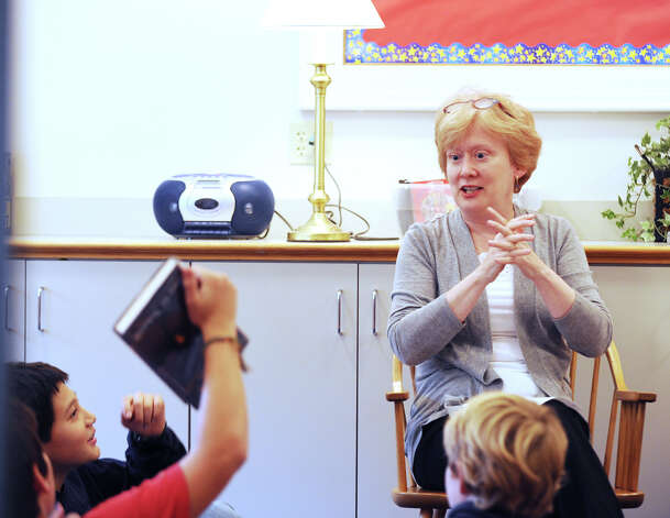 Children's Librarian Kathy Jarombek of Greenwich, leads a young critics reading group at the Perrot Memorial Library where she works in Old Greenwich, Friday afternoon, Oct. 19, 2012. Jarombek was appointed to the selection committee for the prestigious Newbery Medal that is given annually by the Association for Library Service to Children to a selected author for distinguished contribution to American literature. Photo: Bob Luckey / Greenwich Time