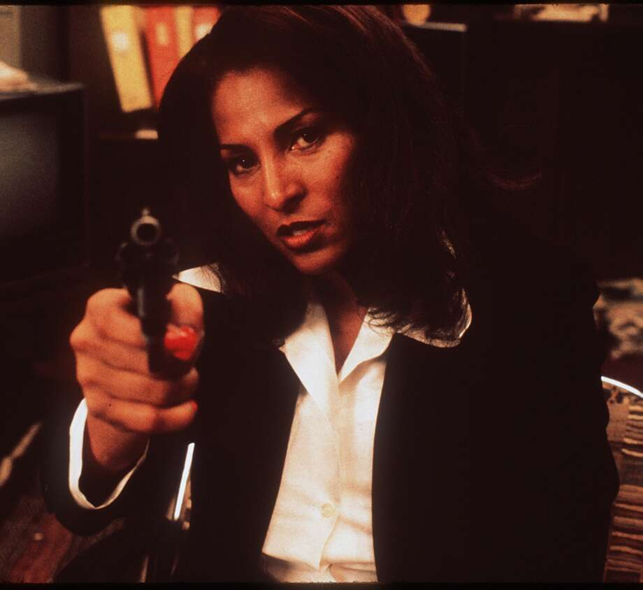 "Pam Grier played some tough, beautiful babes in a series of blaxploitation movies, most famously ""Foxy Brown."" Apologies for finding no photos of Grier and her awesome fro from that era. She's pictured in the 1997 movie ""Jackie Brown."" Photo: DARREN MICHAELS, ."