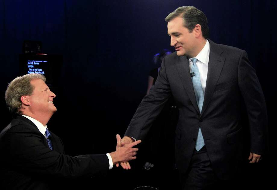 Republican candidate for U.S. Senate Ted Cruz, right, and Democratic candidate Paul Sadler shake hands before their debate at  KERA television studious in Dallas, Friday, Oct. 19, 2012. The two Texas candidates are facing off for the open U.S. Senate seat. Photo: LM Otero, Associated Press / Pool AP