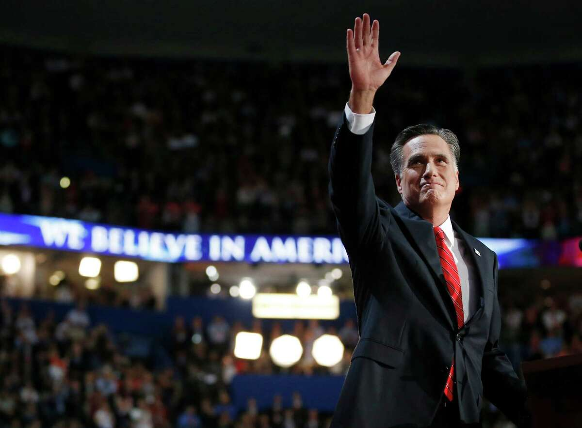 Republican presidential nominee Mitt Romney waves to delegates after speaking at the Republican National Convention in Tampa, Fla., on Thursday, Aug. 30, 2012. (AP Photo/Jae C. Hong)