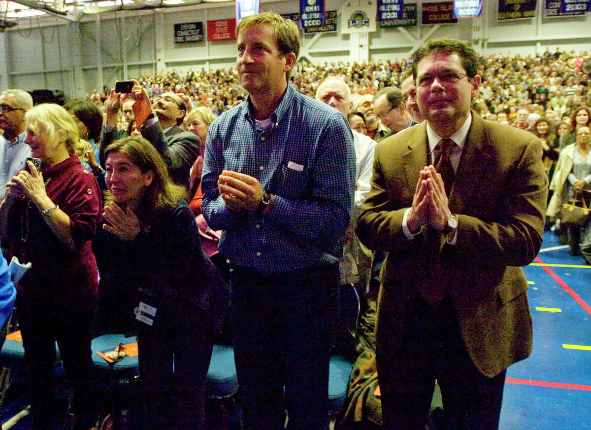 """Spectators greet the Dalai Lama at the O'Neill Center before his speech """"Advice for Daily Life"""" on Western Connecticut State University's westside campus in Danbury on Friday, Oct. 19, 2012."""