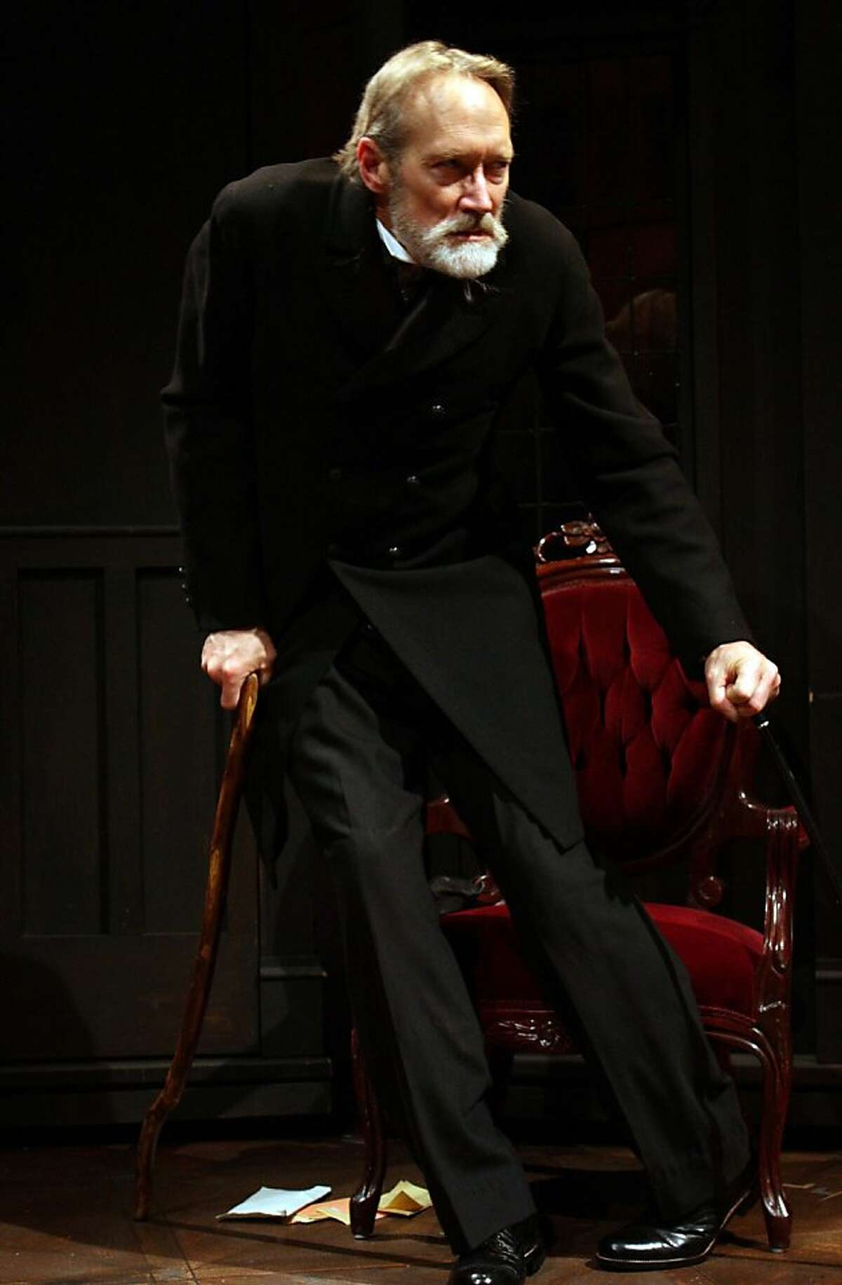 Director Hummel (James Carpenter) storms into the Colonel's house in Cutting Ball Theater's production of Strindberg's