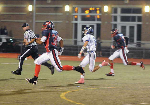 McMahon's Kyle Jordan heads for the end zone as Brien McMahon hosts Fairfield Ludlowe in a football game in Norwalk, Conn., Oct. 19, 2012. Photo: Keelin Daly / Stamford Advocate Freelance