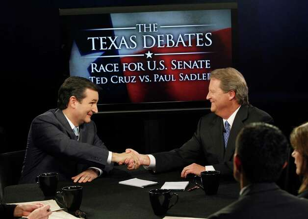 Ted Cruz (left) and Paul Sadler conclude with a handshake after debating who's the best candidate to succeed U.S. Sen. Kay Bailey Hutchison, who's retiring. Photo: LM Otero, Associated Press / Pool, AP