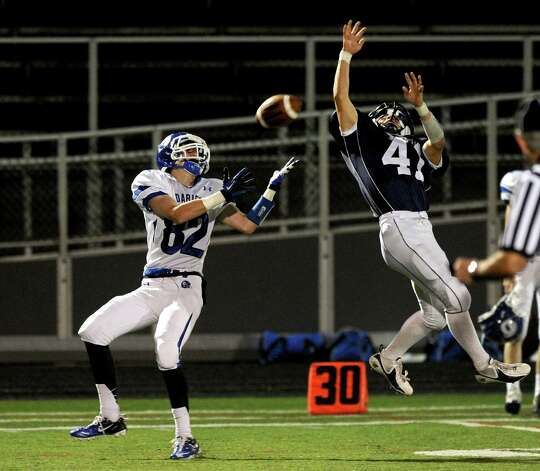 Darien's Graham Lesko, left, makes a catch and runs for a touchdown during Friday's football game at Wilton High School on October 19, 2012. Photo: Lindsay Niegelberg / Stamford Advocate