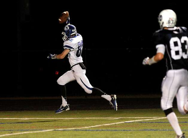 Darien's Graham Lesko celebrates as he scores a touchdown during Friday's football game at Wilton High School on October 19, 2012. Photo: Lindsay Niegelberg / Stamford Advocate