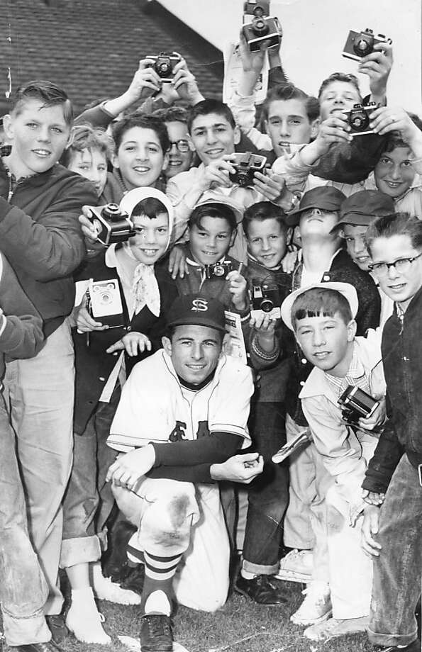 San Francisco Seals outfielder Albie Pearson poses with young fans on camera day at Seals Stadium. April 20, 1957. Photo: Joe Rosenthal, The Chronicle