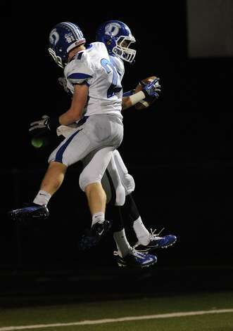 Darien's Graham Lesko celebrates after scoring a touchdown during Friday's football game at Wilton High School on October 19, 2012. Photo: Lindsay Niegelberg / Stamford Advocate