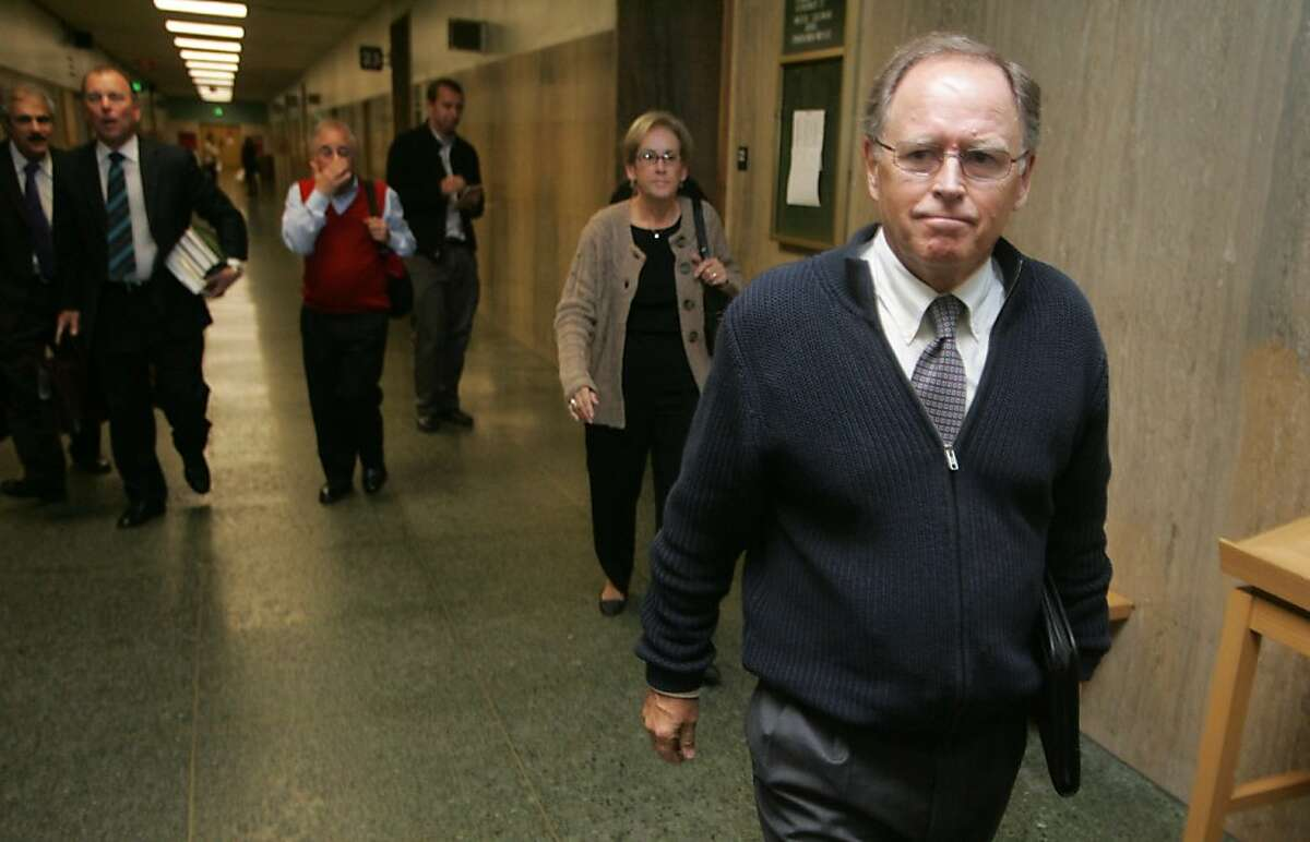 Philip Day, former chancellor of City College of San Francisco, leaves court after being sentenced to five years probation but no restitution for misuse of public funds on Tuesday, Nov. 1, 2011, in San Francisco, Calif.