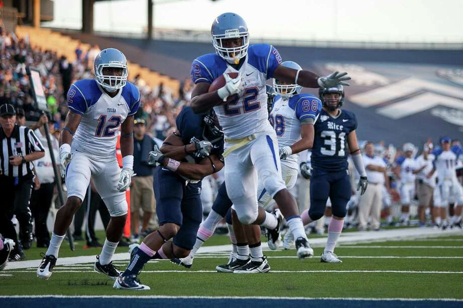 Tulsa tailback Trey Watts (22) rushes for a touchdown in the first half as the Rice Owls take on the Tulsa Golden Hurricane in CUSA action Saturday evening October 22, 2011 at Rice Stadium.   Nathan Lindstrom/Special to the Chronicle  2011 Nathan Lindstrom Photo: Nathan Lindstrom / ©2011 Nathan Lindstrom