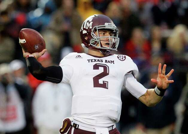 In this Oct. 6, 2012, file photo, Texas A&M quarterback Johnny Manziel throws a short pass in the first quarter of an NCAA college football game against Mississippi in Oxford, Miss. LSU's fast, disciplined defense has shut down dynamic quarterbacks and high-scoring offenses in recent seasons. Still, the Aggies' Manziel got the Tigers' attention when the Aggies put up 59 points last weekend. (AP Photo/Rogelio V. Solis, File) Photo: Rogelio V. Solis, Associated Press / AP