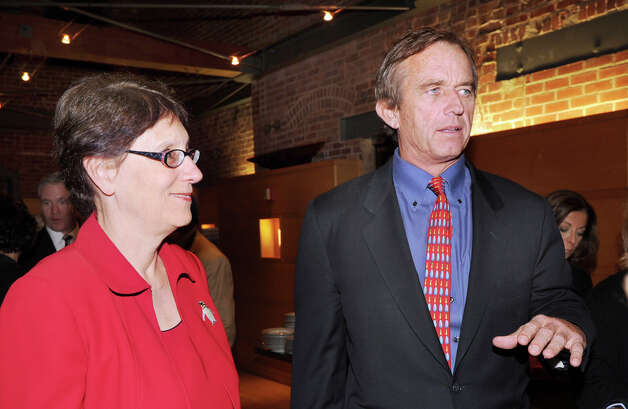 "At left, Jennifer Herring, president of the Maritime Aquarium, with Robert F. Kennedy Jr., an environmental advocate, who was the featured speaker for the first of the new ""Global Insights"" lectures at the Maritime Aquarium in Norwalk, Thursday night, Oct. 18, 2012. Photo: Bob Luckey / Greenwich Time"