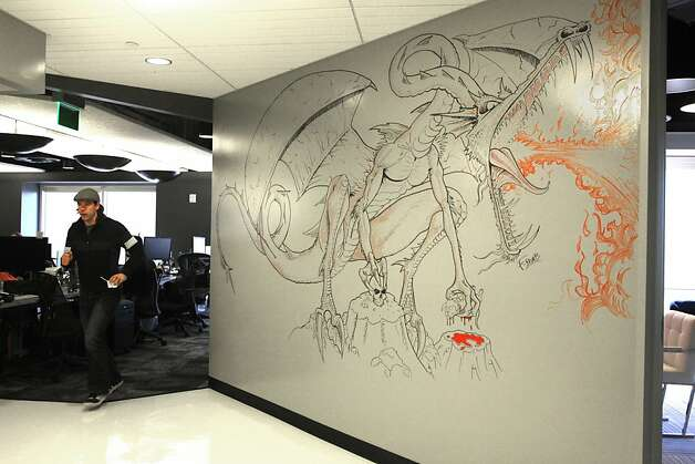The walls at game company Kixeye, with offices near the Financial District and the gates of Chinatown, can be used as whiteboards, like with this elaborate and fiendish dragon. Photo: Liz Hafalia, The Chronicle