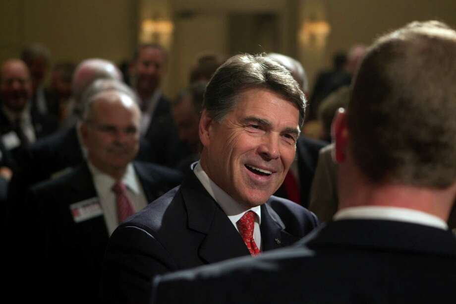 Gov. Rick Perry, whose stem-cell treatment was linked to Celltex, greets attendees after a speaking engagement Friday at The Houstonian Hotel. Photo: Johnny Hanson, Staff / © 2012  Houston Chronicle