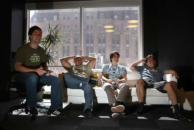 Left to right--PHP developer Matthew Heard, tools engineer Tosh Okonogi, tools engineer Joey Kohn, and systems engineer Manny Ponce playing Mortal Combat at a game room at Kixeye while taking a break in San Francisco, Calif., on Monday, September 24, 2012. Photo: Liz Hafalia, The Chronicle