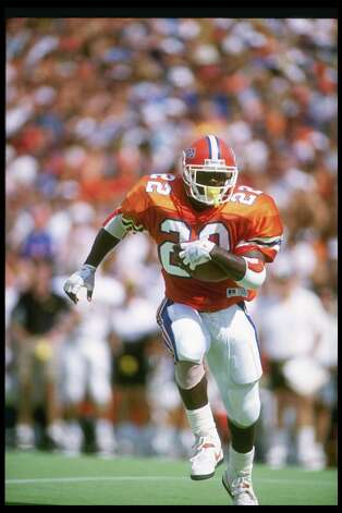 14 Oct 1989: Running back Emmitt Smith of the Florida Gators runs down the field during a game against the Vanderbilt Commadores at Florida Field in Gainesville, Florida. Florida won the game 34-11. Mandatory Credit: Allen Dean Steele /Allsport Photo: Allen Steele, Getty Images / Getty Images North America