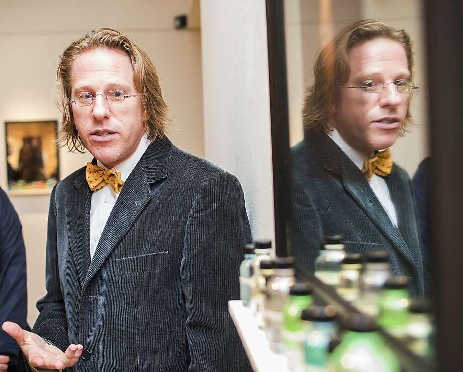 "Artist Jonathon Keats unveiled his ""epigenetic"" cloning at Modernism Gallery in S.F., based on the belief that you are what you ingest. His ""medicine cabinet"" has vials to consume and a picture of the person you want to be. Photo: Stephen Lam, Special To The Chronicle"