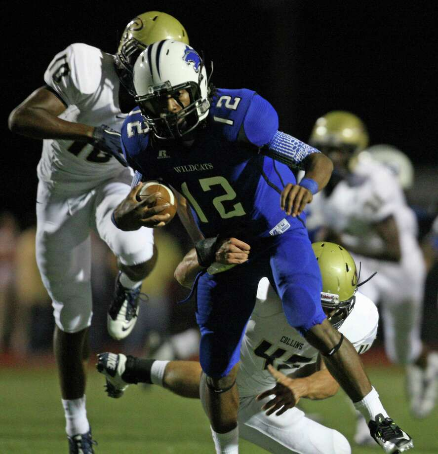 Dekaney quarterback D'Juan Hines (12) is tackled by Klein Collins linebacker Christian Snow during the first half of a high school football game, Friday, October 19, 2012 at George Stadium in Spring, TX. Photo: Eric Christian Smith, For The Chronicle