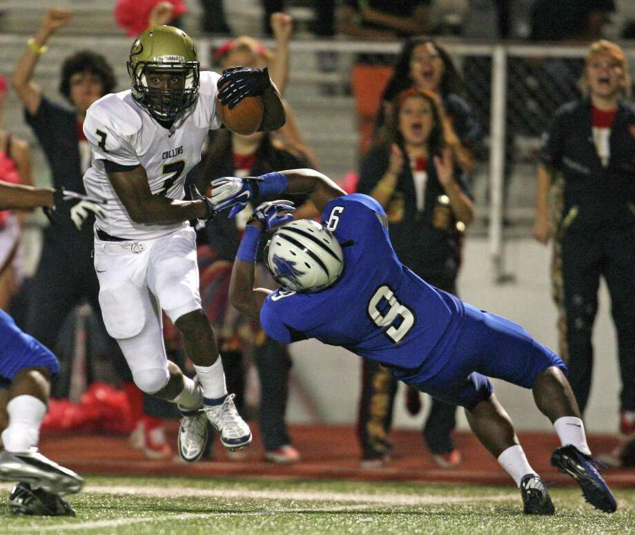 Klein Collins wide receiver Marcus Goodson (3) shakes off Dekaney's Javonte Jackson during the first half of a high school football game, Friday, October 19, 2012 at George Stadium in Spring, TX. Photo: Eric Christian Smith, For The Chronicle
