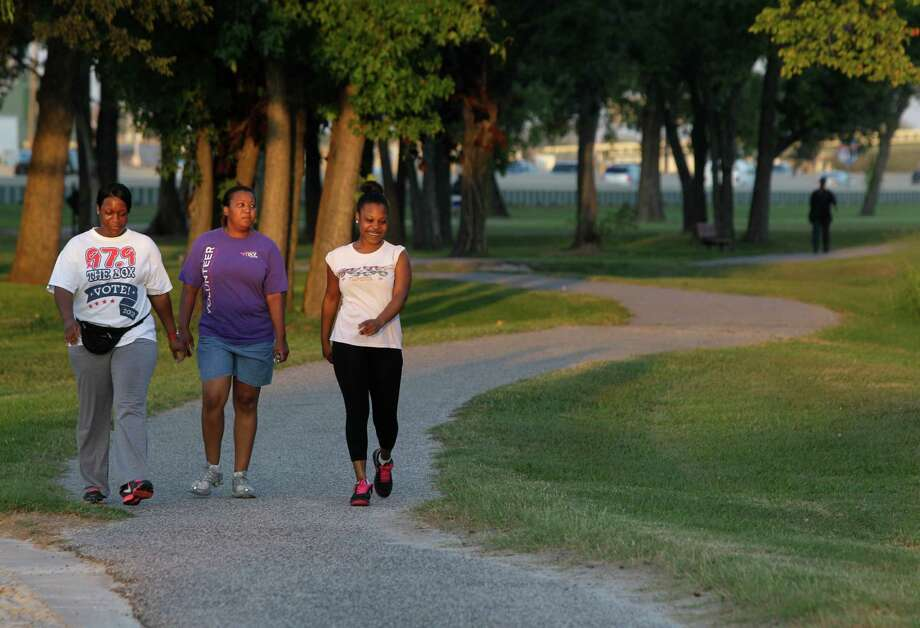 Sherean Goodie, left, Tanya Wilson, and LaTreice Garrett, right, walk in Hutcheson Park near Lockwood and 610, Wednesday, Oct. 17, 2012, in Houston. Parks By You is working to promote the bond measure on the Nov. 6 ballot that would include connecting the Hutcheson Park to the Mickey Leland Memorial Park, 3701 Cavalcade Street, by extending Hunting Bayou Hike and Bike Trail.  ( Melissa Phillip / Houston Chronicle ) Photo: Melissa Phillip / © 2012 Houston Chronicle