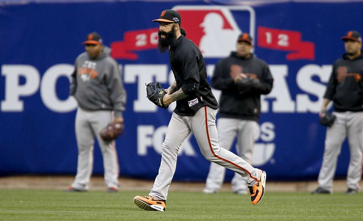 Giants' pitcher Brian Wilson shags balls in the outfield during batting practice, as the San Francisco Giants prepare to take on the St. Louis Cardinals in game five of the National League Championship Series, on Friday Oct. 19, 2012 at Busch Stadium , in St. Louis, Mo.