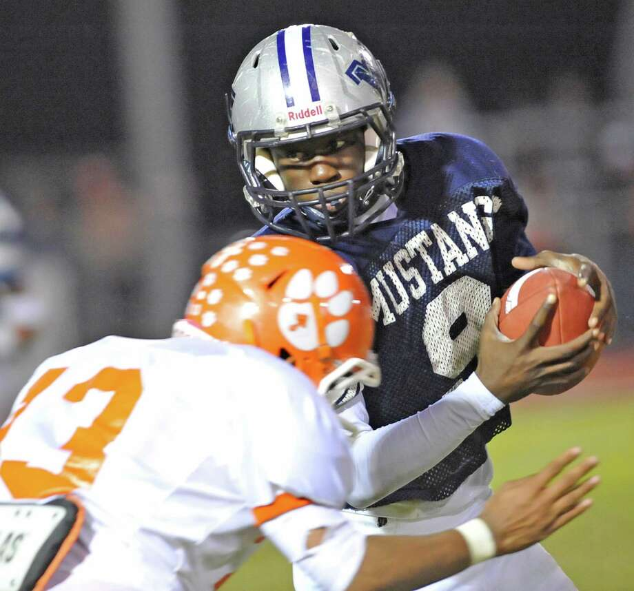Mustang #9, Tremaine Anderson, after catching a pass, turns to head down field, but is stopped by Bobcat #13, Carmichael Wiley. The West Orange Stark Mustangs hosted the Orangefield Bobcats football team at 7 p.m. Friday night at Dan R. Hooks Stadium. This is a District 21-3A game and the Mustangs are ahead at the half 26-0.  Dave Ryan/The Enterprise Photo: Dave Ryan