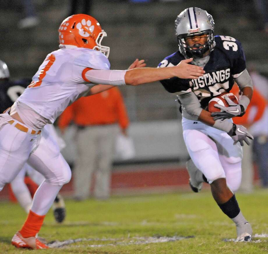 Mustang #35, Abear Simien, right, is about to be tackled by Bobcat #33, Tyron Como as he tries to cut to the side to gain yardage. The West Orange Stark Mustangs hosted the Orangefield Bobcats football team at 7 p.m. Friday night at Dan R. Hooks Stadium. This is a District 21-3A game and the Mustangs are ahead at the half 26-0.  Dave Ryan/The Enterprise