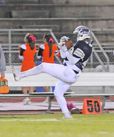 Mustang #49, Daniel Woodson catches a pass right on the boundary line. The West Orange Stark Mustangs hosted the Orangefield Bobcats football team at 7 p.m. Friday night at Dan R. Hooks Stadium. This is a District 21-3A game and the Mustangs are ahead at the half 26-0.  Dave Ryan/The Enterprise Photo: Dave Ryan