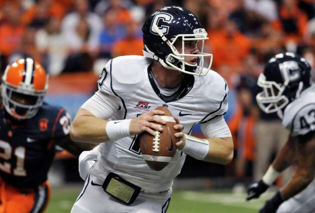 Connecticut quarterback Chandler Whitmer rolls out looking for an open receiver during the second quarter against Syracuse in an NCAA college football game in Syracuse, N.Y., Friday, Oct. 19, 2012. (AP Photo/Kevin Rivoli) Photo: Kevin Rivoli, Associated Press / FR60349 AP