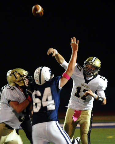 Trumbull QB Nick Roberts tosses a pass, during football action against Staples in Westport, Conn. on Friday October 19, 2012. Photo: Christian Abraham / Connecticut Post