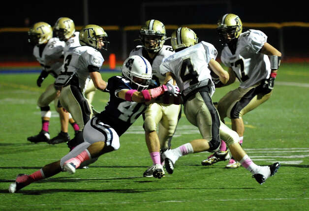 Football action between Staples and Trumbull in Westport, Conn. on Friday October 19, 2012. Photo: Christian Abraham / Connecticut Post