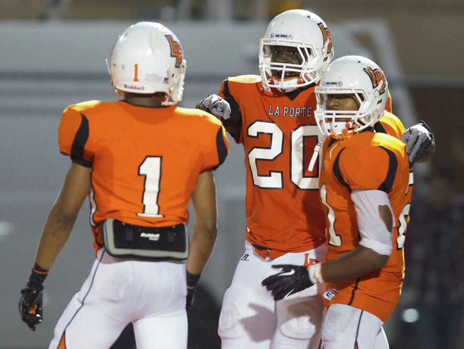 La Porte's Hoza Scott (20) is congratulated by teammates Victor Holmes (1) and Keith Whitely (21) after he recovered a fumble for a touchdown to win the game 20-16 during the fourth quarter of a high school football game against Deer Park at Bulldog Stadium on Friday, Oct. 19, 2012, in La Porte. Photo: J. Patric Schneider, For The Chronicle / © 2012 Houston Chronicle