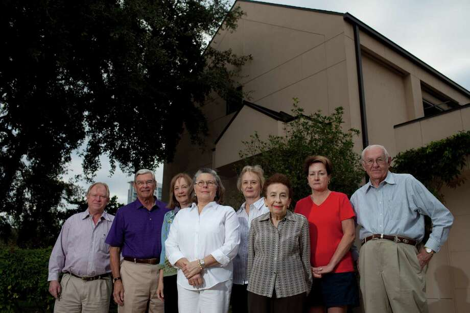 From left, Mavis Kelsey, Tom Keefe, Elizabeth Royce, Maude Carter, Julie McIlherane, Adelma Graham, Rosemary Gafner and Paul Pennington stand before Kelsey's Upper Kirby-area home Oct. 18, 2012 in Houston. Photo: Eric Kayne / 2012 Eric Kayne